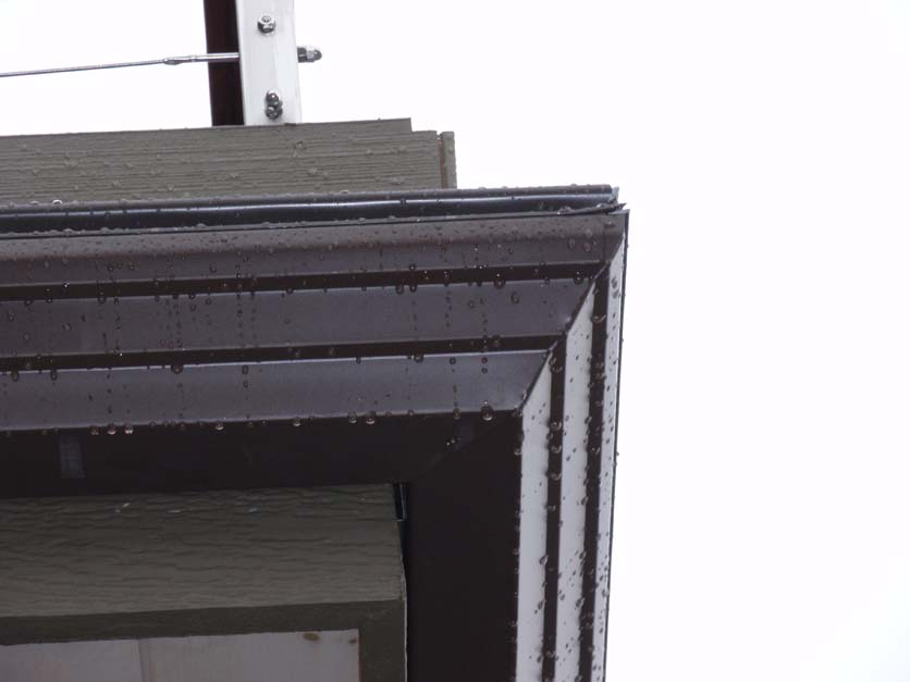 5-2-step aluminum gutter with custom cut corner,Leafproof and duratrac.JPG